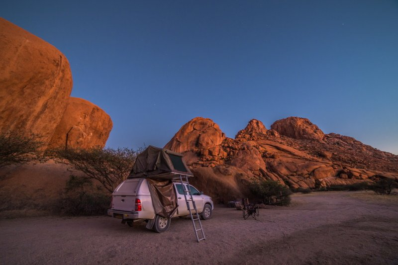 Spitzkoppe, Namibia - 24 MAY 2017 Camping with a 4x4 car (Toyota Hilux) and roof top tent